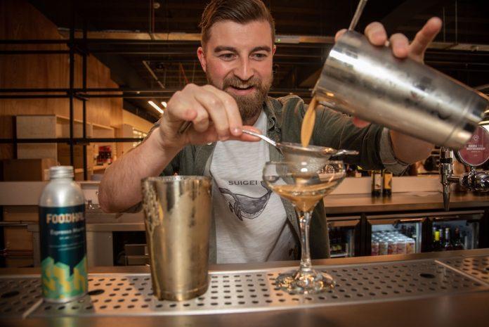 Stretford Foodhall Manager Alex Rice making cocktails.